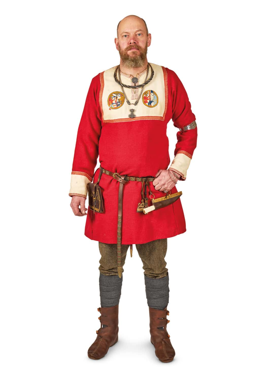 The image shows a Viking man dressed in elaborate clothes